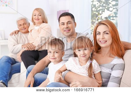 Big happy family sitting on couch