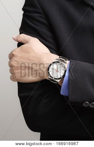 luxury watch on businessman's wrist, luxury accessory for men