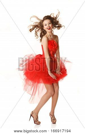 Pin up girl in red dress with flying hair.Professional make-up hair and style
