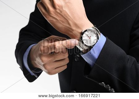 businessman pointing angrily to his watch, luxury watch