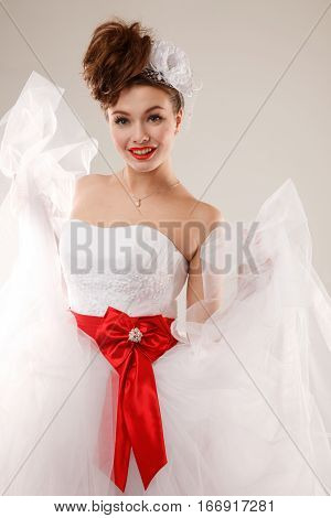 Happy pin-up bride with martini glass.Professional make-up hair and style