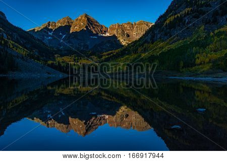 The Iconic Maroon Bells in Autumn at Sunrise