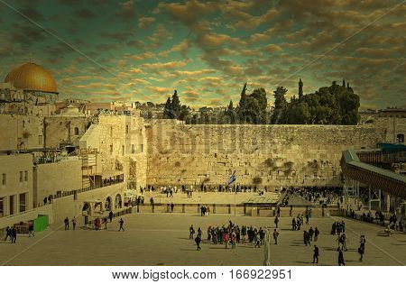 Ancient Western Wall of Temple Mount is a major Jewish sacred place and one of the most famous public domain in the world, Jerusalem, Israel  Textured and toned image for inspiration of retro style