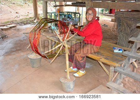 CHIANG RAI THAILAND - JANUARY 8 2017: Thai Weaver at the Anantara Golden Triangle Elephant Camp a charity designed to help elephants and their handlers and families.