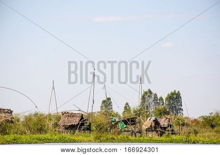 fisherman water hut village Fishing by square dip net