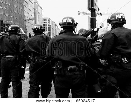 WASHINGTON, Jan. 20, 2017 -- Police chase #DisruptJ20 marchers during the presidential inauguration of Donald Trump, culminating in a mass arrest of 230 protesters charged with