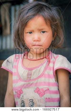 Girl With Short Hair In Nepal