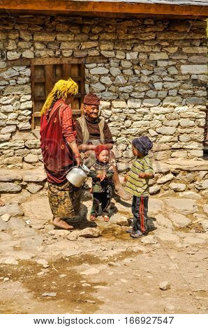 Old Man And Children In Nepal