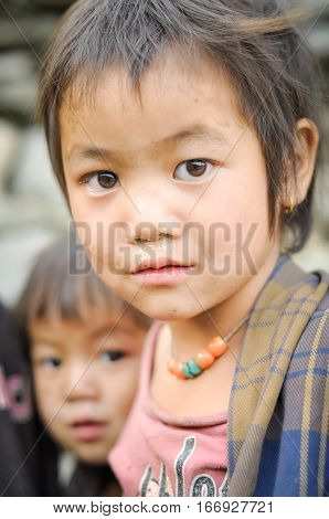 Young Girl With Beads In Nepal