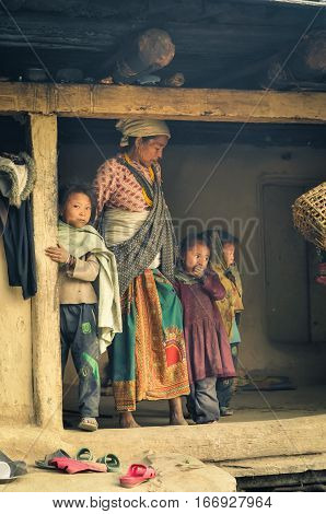 Woman With Three Children In Nepal