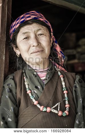 Woman With Beads In Nepal