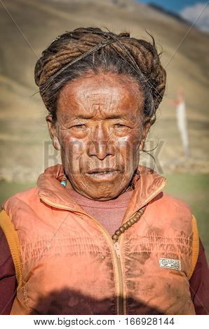 Woman With Sun Tanned Face In Nepal