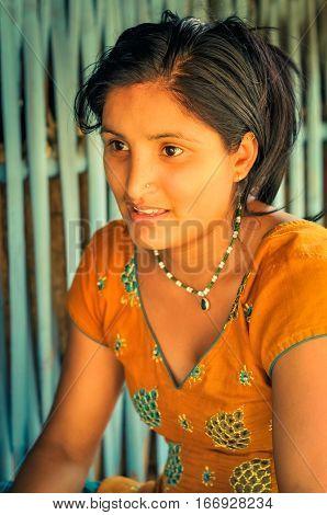 Woman In Orange In Nepal