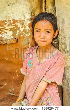 Girl With Flower On Shirt In Nepal