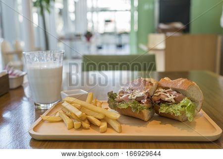 Ham And Cheese Sandwich With French Fries And Milk