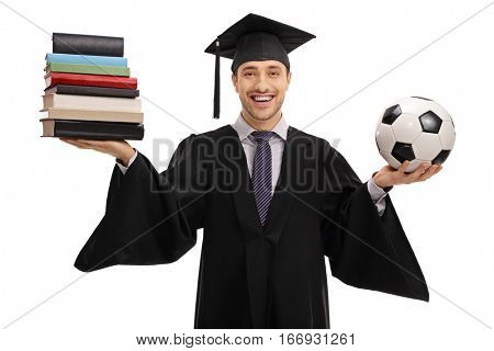 Happy graduate student holding a stack of books and a football isolated on white background