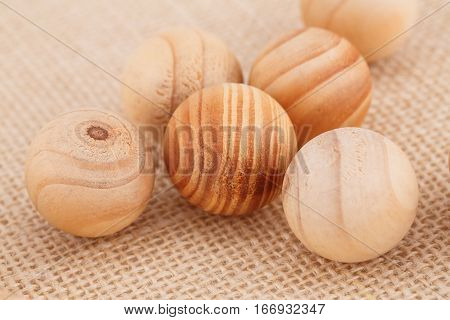 Wooden balls on a beige fabric background.