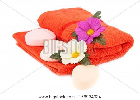 Folded towel soaps and flower isolated on white background.