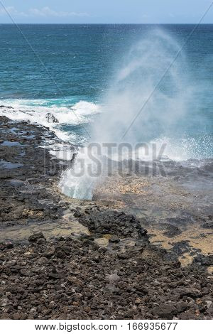 View of the water shot out from a blowhole at Spouting Horn, Kauai, Hawaii