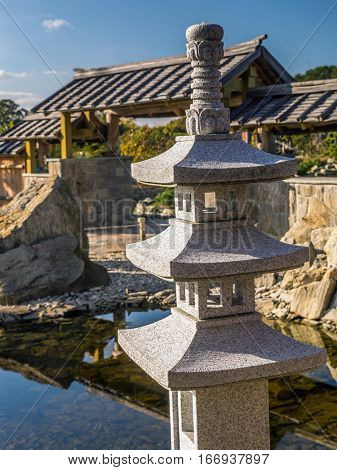 Typical Japanese rock garden with little shrine