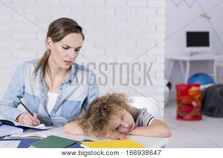 Bored Child At Desk