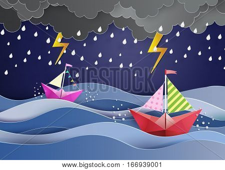 origami made colorful paper sailing boat and raining
