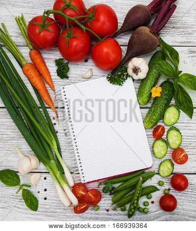 recipe planning concept with raw vegetables and ingredients