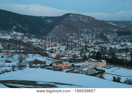 Winter view of little mountain village, Italy