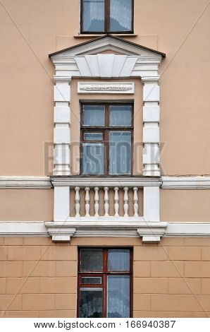 Window of a historic building decorated with classic white elements. Stalin's empire style.