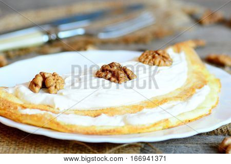 Delicious stuffed omelet. Omelet made with eggs and stuffed with cottage cheese and walnuts. Healthy eating for the whole family. Vegetarian food recipe. Closeup