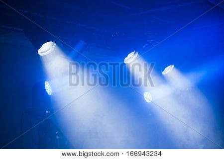 Spot Lights With Blue Rays In Smoky Dark