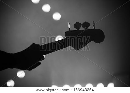 Bass Guitar Over Blurred Stage Lights