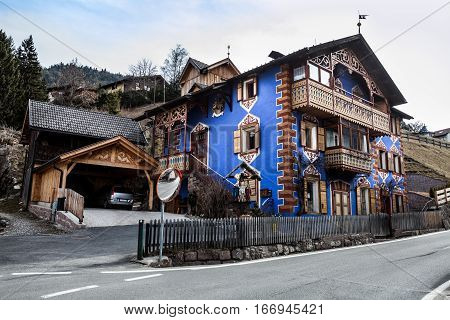 ORTISEI, ITALY. March 28, 2016: Home of the South Tyrol region. Ortisei, Italy. Town of Ortisei, Italy. Exterior garage and street.