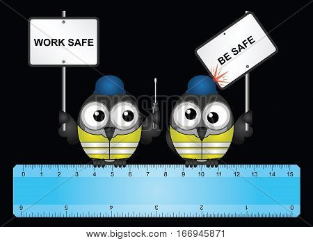 Comical construction workers with health and safety work safe be safe message perched on  a ruler isolated on black background
