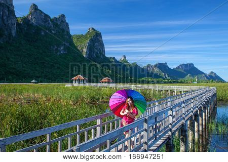 Beautiful young asian woman in mountains on a meadow