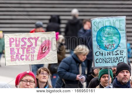Woman´s equality and Donald Trump demonstration.  Stockholm, Sweden - January 21, 2017: Anti-Trump day demonstration and woman´s march in Stockholm January 21, 2017. Protesters with signs and placard.