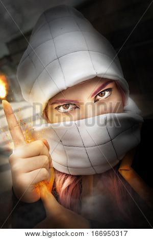 Fire in hand. Cosplayer. Woman with her face covered. A young woman with her face covered showing only the eyes. Her hands give off energy and produce heat and flames. Cosplayer dressed as Japanese manga character.