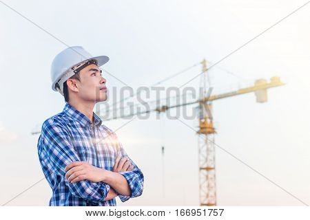 The architect wear white helmet safty on construction site with crane background