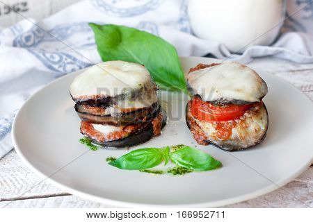 Parmigiana di melanzane: baked eggplant - italy, sicily cousine. On the wooden table.