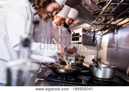 Group of chef preparing food in the kitchen of a restaurant