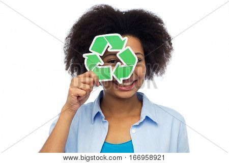 people, ecology, conservation and recycling concept - happy african american young woman looking through recycle symbol over white