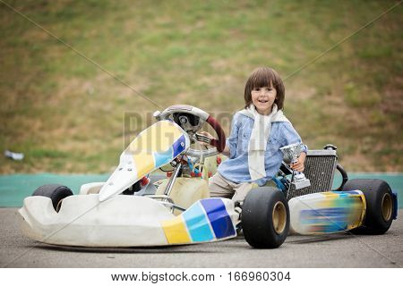 Cute Child, Riding Go Cart, Wins Champion Cup