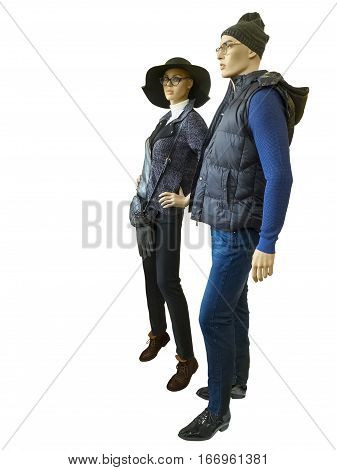Two full-length mannequins male and female dressed in fashionable clothes isolated on white background. No brand names or copyright objects.