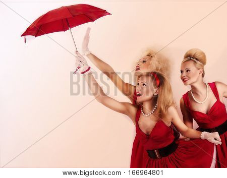 Three isolated cute girls with umbrella. pin-up style.