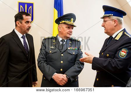 Záhony Hungary - January 25 2017: Head of the State Borderguard Service of Ukraine colonel general Viktor Nazarenko (C) and the deputy police chief - chief of law enforcement of Hungary major general Zsolt Halmosi (R) communicate during the opening of the