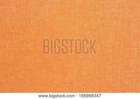 A pattern of a orange fabric filling the frame
