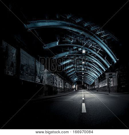 Illuminated steel construction of a railway bridge underpass