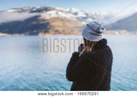 Woman walking by the lake. Travel Into the wild concept.