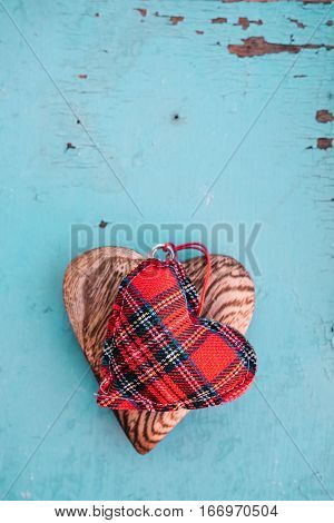 Linen and wooden heart on blue wooden background