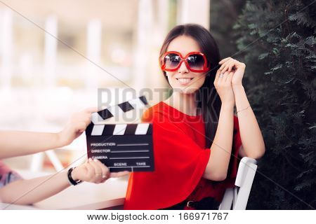 Happy Actress with Oversized Glasses Shooting Movie Scene